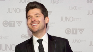 Matt Dusk arrives on the red carpet during the Juno Awards in Winnipeg, Sunday, March 30, 2014. (THE CANADIAN PRESS/John Woods)