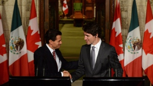 Prime Minister Justin Trudeau shakes hands with Mexican President Enrique Pena Nieto during a joint news conference on Parliament Hill in Ottawa, Tuesday June 28, 2016. THE CANADIAN PRESS/Adrian Wyld