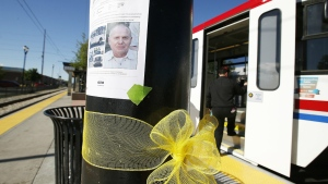 A yellow ribbon is tied below a photo of Utah Transit Authority employee Kay Porter Ricks at the UTA Trax Ballpark station in Salt Lake City on May 18, 2016. (Jeffrey D. Allred / The Deseret News)