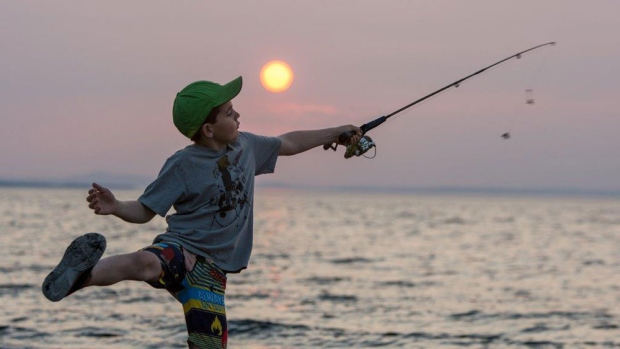 8 yr old Mikka Barrest launches his line hoping to catch some bass in Belledune NB.