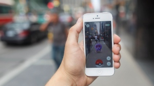 A Pokemon appears on a smartphone playing Pokemon Go in downtown Toronto, Ontario on Tuesday, July 19, 2016. (THE CANADIAN PRESS/Cole Burston)