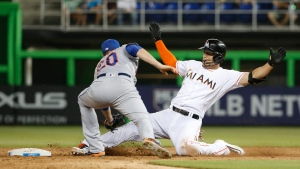 New York Mets second baseman Neil Walker (20) tags out Miami Marlins' Giancarlo Stanton, who tried to stretch a single into a double during the sixth inning of a baseball game, Friday, July 22, 2016, in Miami. (AP / Wilfredo Lee)