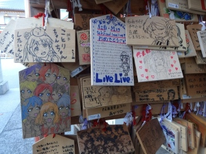 This Dec. 8, 2015 photo taken at Kanda Shrine in Tokyo shows prayer plaques decorated with anime fan art at the shrine, a setting for the series 'Love Live! School Idol Project.' Anime tourism is a phenomenon in Japan, with fans hunting down real-world places that are used as settings in the cartoons. (Linda Lombardi via AP)
