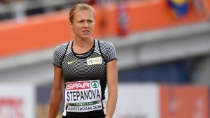 In this July 6, 2015 file photo Russian doping whistleblower Yuliya Stepanova leaves the track after suffering an injury in a women's 800m heat during the European Athletics Championships in Amsterdam. (AP / Geert Vanden Wijngaert, file)