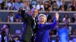 U.S. President Barack Obama and Democratic Presidential candidate Hillary Clinton wave together during the third day of the Democratic National Convention in Philadelphia , Wednesday, July 27, 2016. (AP / Mark J. Terrill)