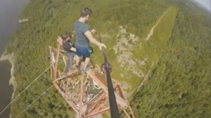 Two teens scaling a high-power transmission tower near Saint John. (Facebook/Noah Kingston)