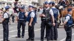 Police men patrol during the Belgian National Day parade in Brussels on Thursday July 21, 2016. (AP Photo/Geert Vanden Wijngaert)