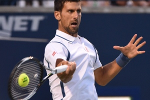 Novak Djokovic, of Serbia, returns a shot from Gael Monfils, of France, in men's semifinal Rogers Cup tennis action, in Toronto on Saturday, July 30, 2016. (Jon Blacker / THE CANADIAN PRESS)