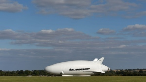 The Airlander 10, part plane, part airship, goes through pre-flight checks at Cardington airfield in Bedfordshire, England, Sunday Aug. 14, 2016. (Joe Giddens/PA via AP)