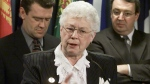 Conservative MP Elsie Wayne adds her support to an anti-child pornography camapign while Darrel Reid (left) of Focus Canada and Liberal MP Dan McTeague (right) look on during a news conference in Ottawa, Thursday, April 11, 2002. (CP PHOTO/Fred Chartrand)