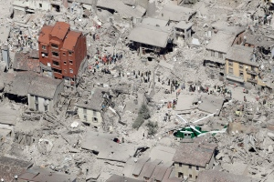 This aerial photo shows the damaged buildings in the historical part of the town of Amatrice, central Italy, after an earthquake, Wednesday, Aug. 24, 2016. (AP Photo/Gregorio Borgia)