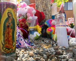 A memorial for a 10-year-old girl who police said was sexually assaulted, strangled then dismembered is seen at an Albuquerque, N.M., apartment building Thursday, Aug. 25, 2016. (AP / Russell Contreras)
