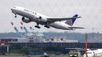 FILE - In this July 25, 2013, file photo, a United Airlines plane takes off from Newark Liberty International Airport, in Newark, N.J. United Airlines said Thursday, July 14, 2016, it will pay a $2.25 million fine but won't be charged in connection with a special flight from Newark, N.J., that benefited the former head of the agency that runs the airport. (AP Photo/Julio Cortez, File)