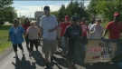 Residents marched through North Preston, N.S, on Sunday in an effort to take back their streets.