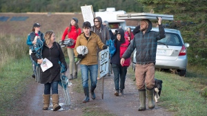 Cheryl Maloney, a Mi'kmaq activist, leads protesters to a blockade of a worksite near the Shubenacadie River in Fort Ellis, N.S. on Monday, Sept. 26, 2016. Alton Natural Gas Storage LP plans to build natural gas storage caverns in salt beds nearby and the company will gradually release 1.3 million cubic metres of salt into the river system over a three-year period. (THE CANADIAN PRESS/Andrew Vaughan)