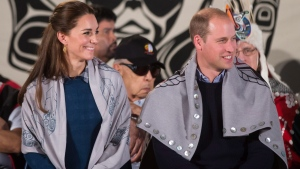 The Duke and Duchess of Cambridge sit together after being draped in traditional First Nation blankets during a welcoming ceremony at the Heiltsuk First Nation in the remote community of Bella Bella, B.C., on Monday, September 26, 2016. THE CANADIAN PRESS/Darryl Dyck
