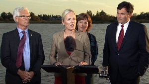 Environment and Climate Change Minister Catherine McKenna announces the approval of the Pacific NorthWest LNG project in Richmond B.C., Tuesday, Sept. 27, 2016. Natural Resources Minister Jim Carr, left to right in back, B.C. Premier Christy Clark and Fisheries Minister Dominic LeBlanc look on.