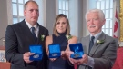 Karl Curtis, Nicole Foran and Jerry Spargo, left to right, display the Medal of Bravery at Province House in Halifax on Wednesday, Sept. 28, 2016. (THE CANADIAN PRESS/Andrew Vaughan)