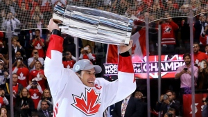 Team Canada's Sidney Crosby hoists the trophy following his team's victory over Team Europe during World Cup of Hockey finals action in Toronto on Thursday, Sept. 29, 2016. (Bruce Bennett / THE CANADIAN PRESS)