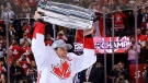 Team Canada's Sidney Crosby (87) hoists the trophy following his team's victory over Team Europe during World Cup of Hockey finals action in Toronto on Thursday, September 29, 2016. (THE CANADIAN PRESS/Bruce Bennett/POOL)