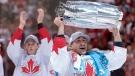 Team Canada centre Brad Marchand (63) hoists the cup as teammate Jonathan Toews applauds after defeating Team Europe in World Cup of Hockey finals action in Toronto on Thursday, September 29, 2016. (THE CANADIAN PRESS/Frank Gunn)