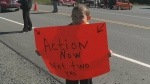 Potlotek First Nation residents young and old slowed down traffic on Friday spread their message.