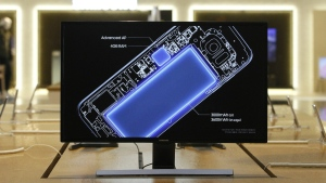 A screen shows an internal design drawing of Samsung Electronics Galaxy S7 smartphone at its shop in Seoul, South Korea on Wednesday, Oct. 12, 2016. (AP / Ahn Young-joon)