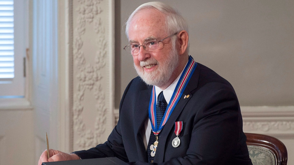 Arthur McDonald, a native of Sydney, N.S. who won the 2015 Nobel Prize in Physics, is awarded the Order of Nova Scotia at Province House in Halifax on Wednesday, Oct. 12, 2016. (THE CANADIAN PRESS/Andrew Vaughan)