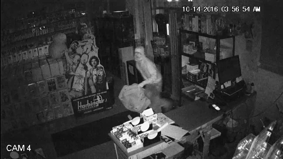 This image from security footage shows a suspected robber at the Comic Hunter in Moncton, N.B., on Friday, Oct. 14, 2016. (The Comic Hunter / Facebook)
