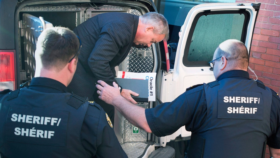 Dennis Oland arrives at the Court of Appeal in Fredericton on Tuesday, Oct. 18, 2016. Oland, convicted of murder in the death of his father Richard Oland, is appealing his conviction. (THE CANADIAN PRESS/Andrew Vaughan)