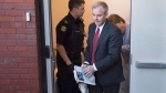 Dennis Oland is taken from the Court of Appeal in Fredericton on Wednesday, Oct. 19, 2016. Oland, convicted of murder in the death of his father Richard Oland, is appealing his conviction. Three days have been set aside to hear the arguments. THE CANADIAN PRESS/Andrew Vaughan