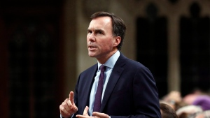 Finance Minister Bill Morneau stands in the house of Commons during Question Period. Tuesday October 18, 2016., 2016. (THE CANADIAN PRESS/Fred Chartrand)