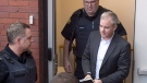 Dennis Oland heads from court in Fredericton on Monday, Oct. 24, 2016. THE CANADIAN PRESS/Andrew Vaughan