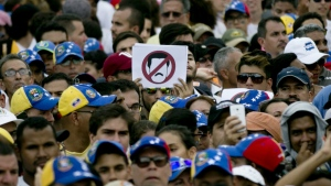 People protest against Venezuela's President Nicolas Maduro in Caracas, Venezuela on Wednesday, Oct. 26, 2016. (AP / Ariana Cubillos)