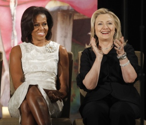 In this March 8, 2012, file photo, then-Secretary of State Hillary Clinton and first lady Michelle Obama attend the 2012 International Women of Courage Awards at the State Department in Washington.  (AP / Charles Dharapak)