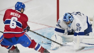 Montreal Canadiens' Shea Weber slides in on Tampa Bay Lightning's goaltender Ben Bishop during second period NHL hockey action in Montreal on Thursday, October 27, 2016. (Graham Hughes / THE CANADIAN PRESS)