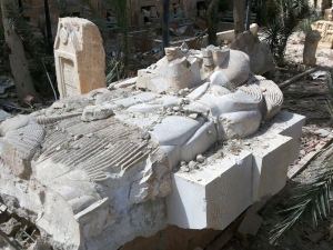 This photo released on Sunday March 27, 2016, by the Syrian official news agency SANA, shows a destroyed statue outside the damaged Palmyra Museum, in Palmyra city, central Syria. (SANA via AP, File)