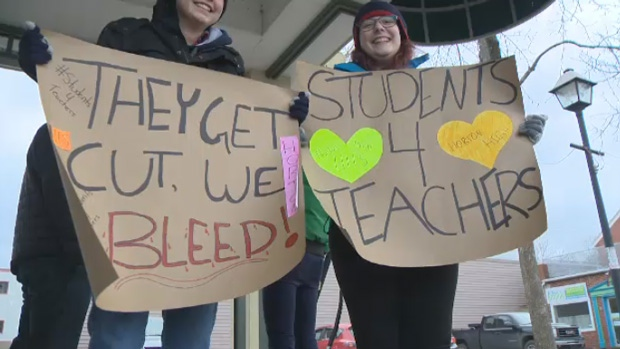 Students hold up signs at a rally for Nova Scotia teachers in Kentvile, N.S., on Sunday, Dec. 4, 2016.