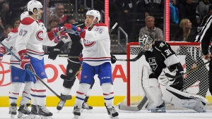 Montreal Canadiens left wing Max Pacioretty, left, celebrates his goal with center Andrew Shaw, center, as Los Angeles Kings goalie Peter Budaj, of Slovakia, gets up from the ice during the second period of an NHL hockey game, Sunday, Dec. 4, 2016, in Los Angeles. (Mark J. Terrill/AP Photo)