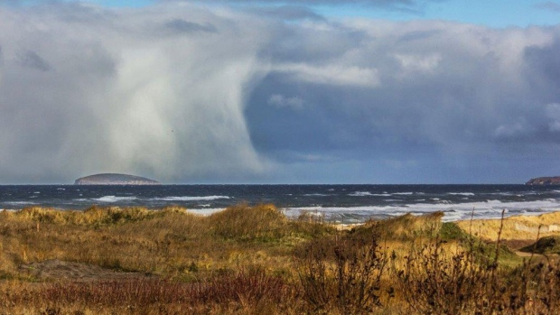 This wall of rain and snow was photographed by Francis MacDonald near Margaree Island NS.