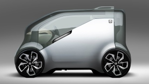 The Honda NeuV, a concept automated electric commuter vehicle equipped with artificial intelligence, is seen in this provided image. © Honda