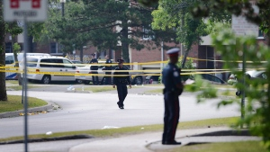 Toronto police on Danzig Street, on July 17, 2012. (Aaron Vincent Elkaim / THE CANADIAN PRESS)