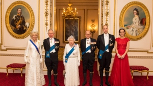 Britain's Queen Elizabeth II and Prince Philip, Prince Charles and the Duchess of Cornwall, left, Prince William and the Duchess of Cambridge arrive for the annual evening reception for members of the Diplomatic Corps at Buckingham Palace, London, Thursday Dec. 8, 2016. The Duchess of Cambridge wears the Cambridge Lover's Knot Tiara, a favorite tiara of the late Princess Diana. (Dominic Lipinski/PA via AP)