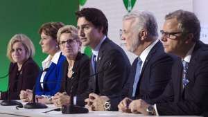Canadian Prime Minister Justin Trudeau speaks during a news conference with Albeta Premier Rachel Notley (left), B.C. Premier Christy Clark , Ontario Premier Kathleen Wynne , Quebec Premier Philippe Couillard and Saskatchewan Premier Brad Wall at the United Nations climate change summit Monday, November 30, 2015 in Le Bourget, France. (The CANADIAN PRESS/Adrian Wyld)