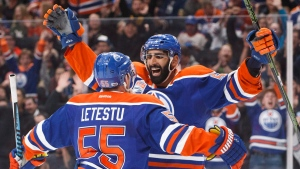 Edmonton Oilers' Mark Letestu (55) and Jujhar Khaira (54) celebrate a goal on Monday January 16, 2017. (THE CANADIAN PRESS/Jason Franson)