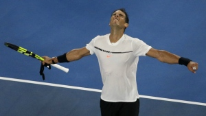 Spain's Rafael Nadal celebrates after defeating Marcos Baghdatis of Cyprus in their second round match at the Australian Open tennis championships in Melbourne, Australia, Friday, Jan. 20, 2017. (AP / Dita Alangkara)