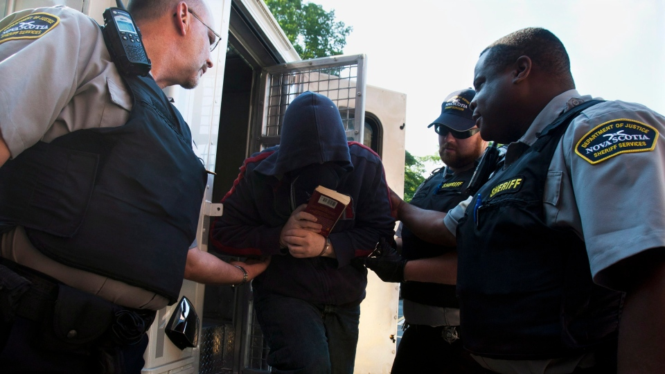 Sub.-Lt. Jeffrey Paul Delisle arrives at provincial court in Halifax on Wednesday, July 4, 2012. (Andrew Vaughan / THE CANADIAN PRESS)