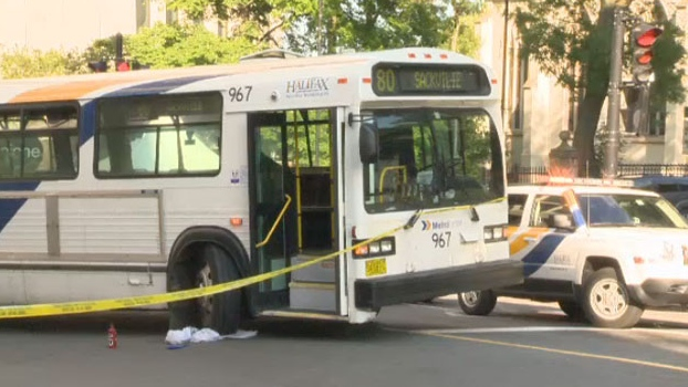 Halifax Regional Police investigate the scene of a bus accident at the corner of Spring Garden Road and Barrington Street.