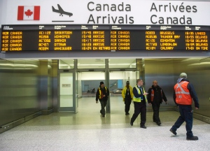 Air Canada workers are seen at Pearson International Airport in Toronto on Thursday, March 8, 2012. (Nathan Denette / THE CANADIAN PRESS)