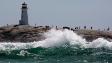 Waves pound the rocks at Peggys Cove, N.S. on Monday, Aug. 29, 2011. (Andrew Vaughan / THE CANADIAN